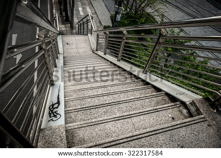 Old metal stairs of the overpass in Bangkok city thailand. #322317584