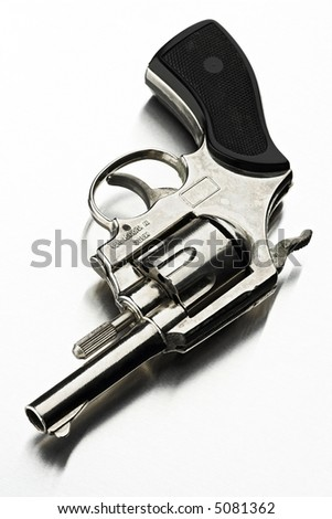 old metal toy revolver on white
