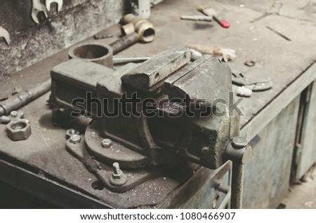 Old metal vise in the metalwork shop - Shutterstock ID 1080466907