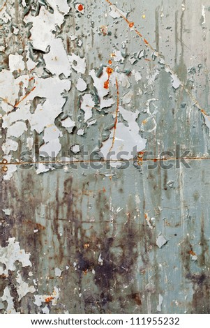 Old metal wall with paint peeling off