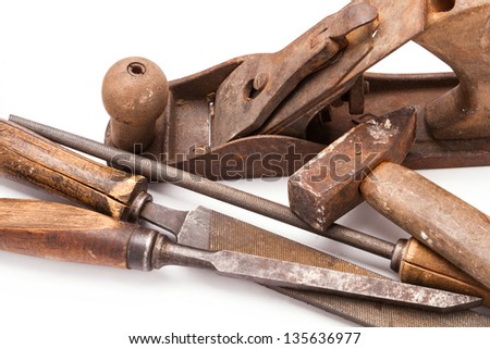 old metal work hand tools with rust on white background - stock photo