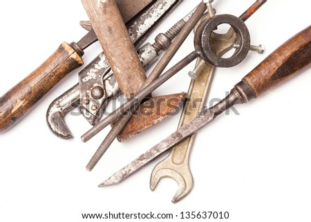 old metal work hand tools with rust on white background