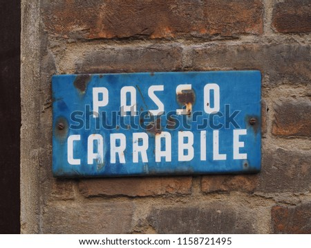 Old metallic italian sign indicating a driveway. Passo carrabile means driveway.