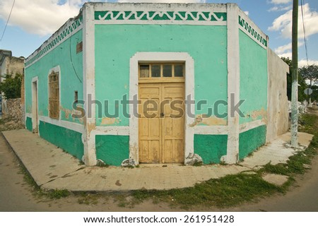 Old Mexican village of Celestun on Gulf of Mexico with old green building storefront