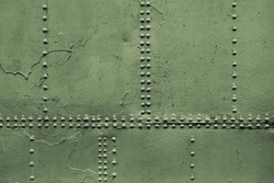Old military green metal sheets with rivets, background photo texture