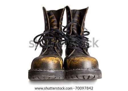 Old military style boots isolated on white background
