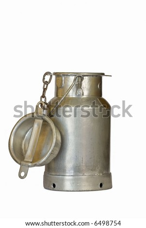 Old milk churn against white background - stock photo
