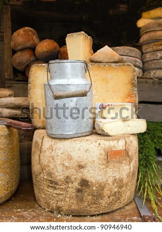 old milk jug and cheese, presented in a market in France
