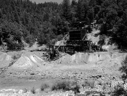 old mine site falling apart across a creek timbered structure falls into decay historical