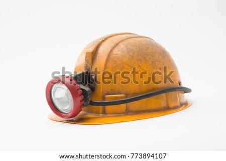 old miner helmet with lamp on...