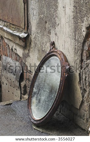 Old Mirror Standing Against Wall
