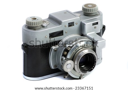 Old  35 mm metal chrome photo camera with lens