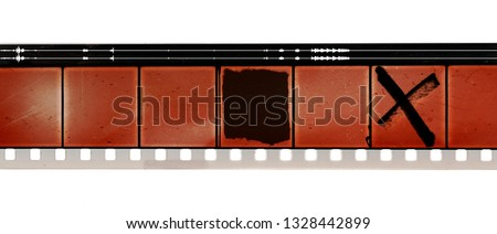 Photo of  old 16mm movie film strip on white background