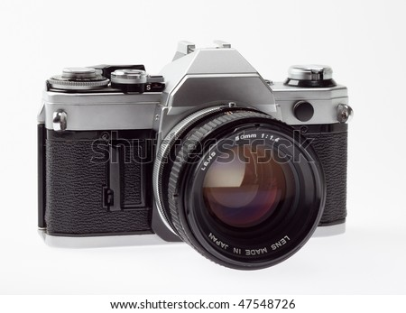 old 35mm SLR camera, angle view, on a white background.