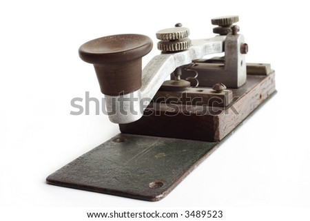 Old morse key on white background