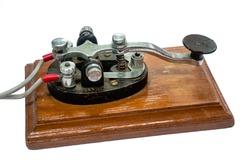 old morse key telegraph on wood table