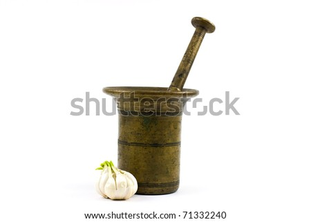 Old mortar with a garlic