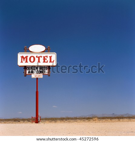 Old motel sign in the desert. This photo has been made on public domain