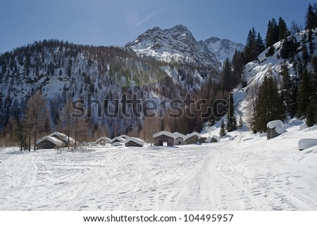 old mountain village with little stone houses, shooting in backlit with lens flare