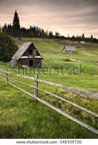 Old mountain village with wooden houses in a forest