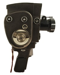 Old movie camera with lens close up