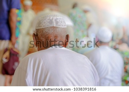 Old Muslim man praying #1038391816