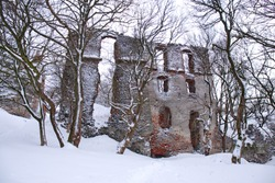 old mysterious ruin castle in Carpathians in winter cloudy day