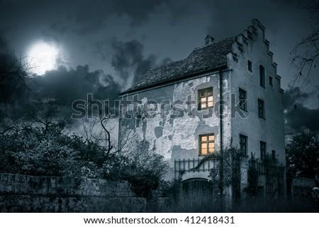 Stock Photo Old mystic villa in moonlight