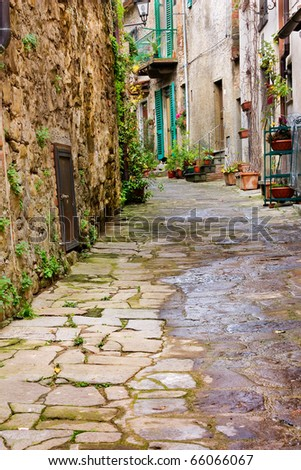 old narrow alley in tuscan village - antique italian lane - tuscany, italy