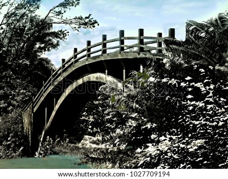 old narrow cement bridge over a ...