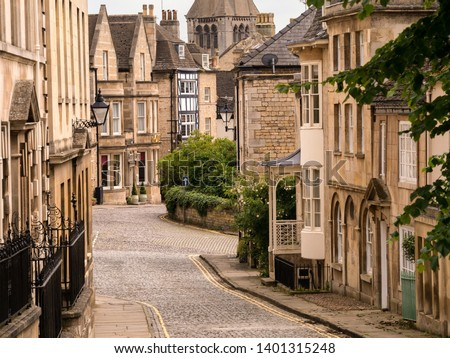Old narrow cobbled street with stone houses, Barn Hill and All Saints Place, Stamford, Lincolnshire, England,UK