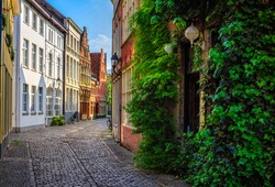 Old narrow street in Ghent (Gent), Belgium. Architecture and landmark of Ghent. Cozy cityscape of Ghent.