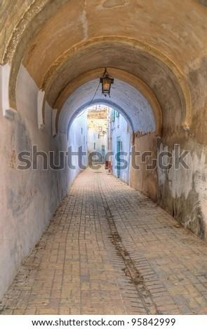 stock-photo-old-narrow-street-in-kairouan-tunisia-95842999.jpg