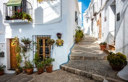 Old narrow streets in Europe. White houses narrow street. Old town narrow street