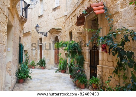 Old narrow town street of Vittoriosa. Malta