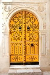 Old national Tunisian painted door in the Medina.Tunisia.