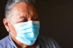 Old native american man wearing mask.