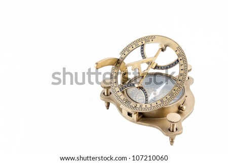 Old nautical sundial compass isolated in a white background
