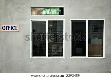 """Old neon """"No Vacancy"""" sign outside a motel office"""