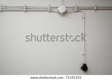 Old network electrical cables on the wall.