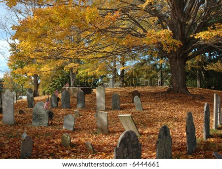 Old New England cemetery under a canopy of fall foliage in late October