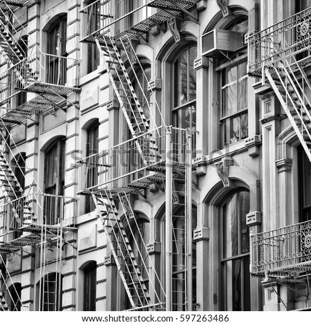 Old New York City architecture. Fire escape stairs. Black and white style. #597263486
