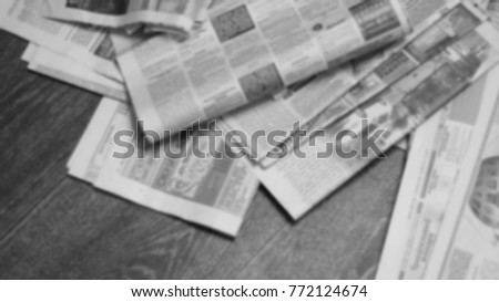 Old newspapers scattered on wooden floor. Lots of retro journals with headlines, articles and photos. Background texture, blurred, top view #772124674