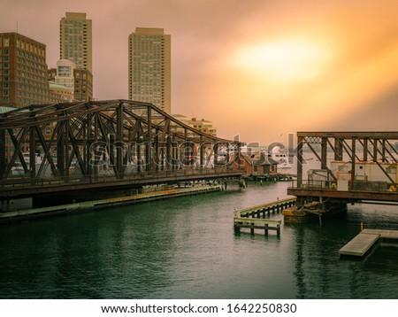 Old Northern Avenue Bridge in Boston with moody twilight sky