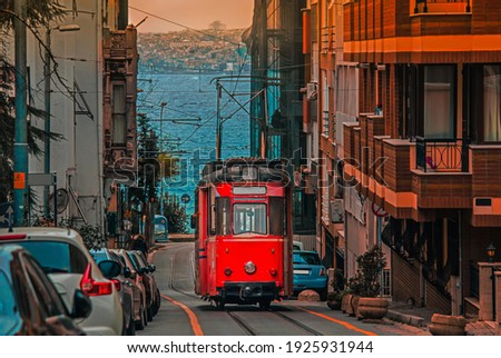 Old nostalgic tram going through the streets of Kadikoy district on the Asian side of Istanbul. The trendy neighborhood is full of colorful buildings. Marmara Sea. Stockfoto ©