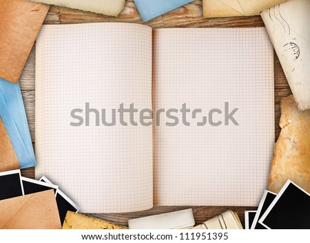 Old note book, paper and instant photos. Objects over old wood background
