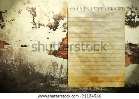 Old notebook paper on wall background