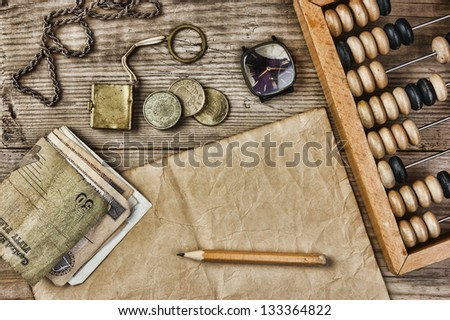 old notes and coins and abacus...