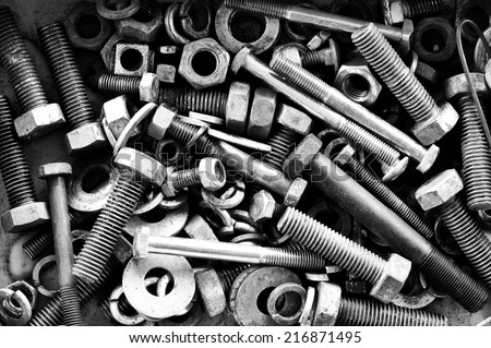 Old nut and bolts for background, Black and white photo.