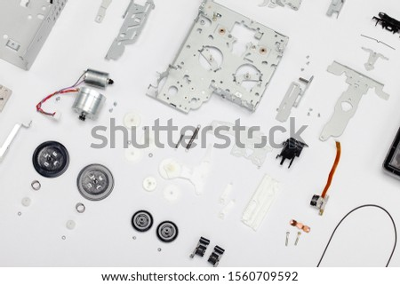 Old obsolete electronics disassembled. Case, knobs, screws, motor, magnetic head, springs and other parts